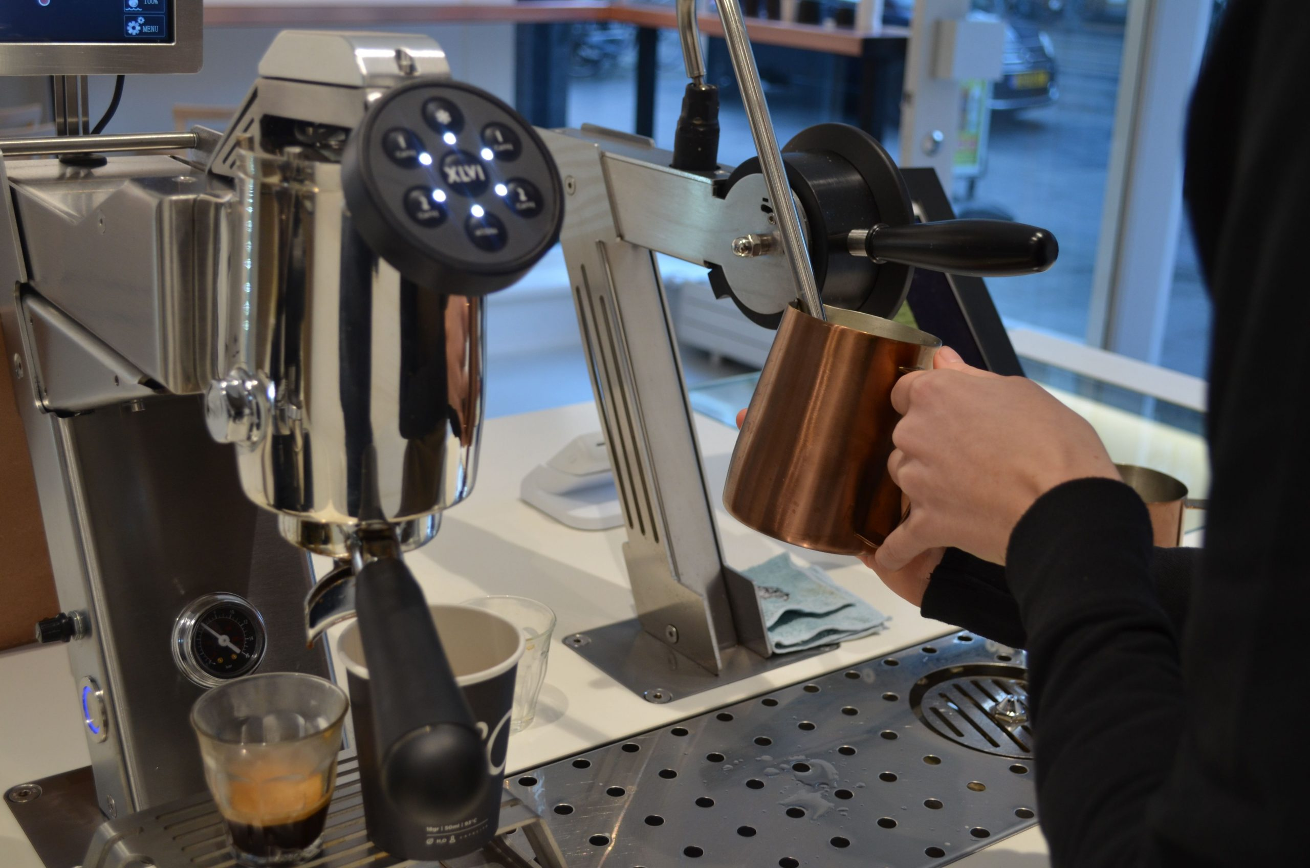 Espressobar Amsterdam, coffee machine in use